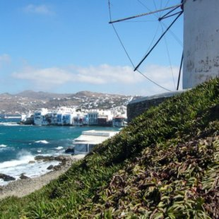 A windmill overlooking the sea in Mykonos, one of the Cyclades Islands.